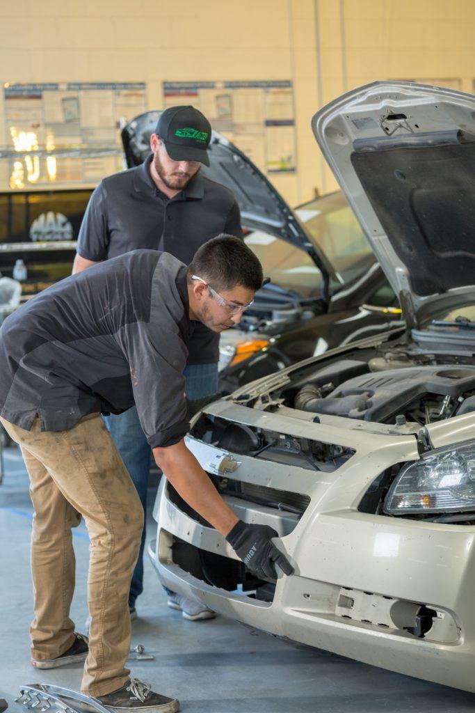 two men repairing car in Body Shop Glendale AZ